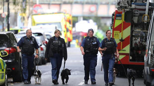 Police near the Parsons Green underground station after the attack in London during the week.