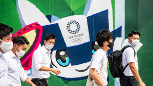 Officials in Tokyo are forging ahead with hosting the Olympics from July 23