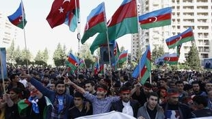 People attend an opposition rally in Baku, 12 October, 2013