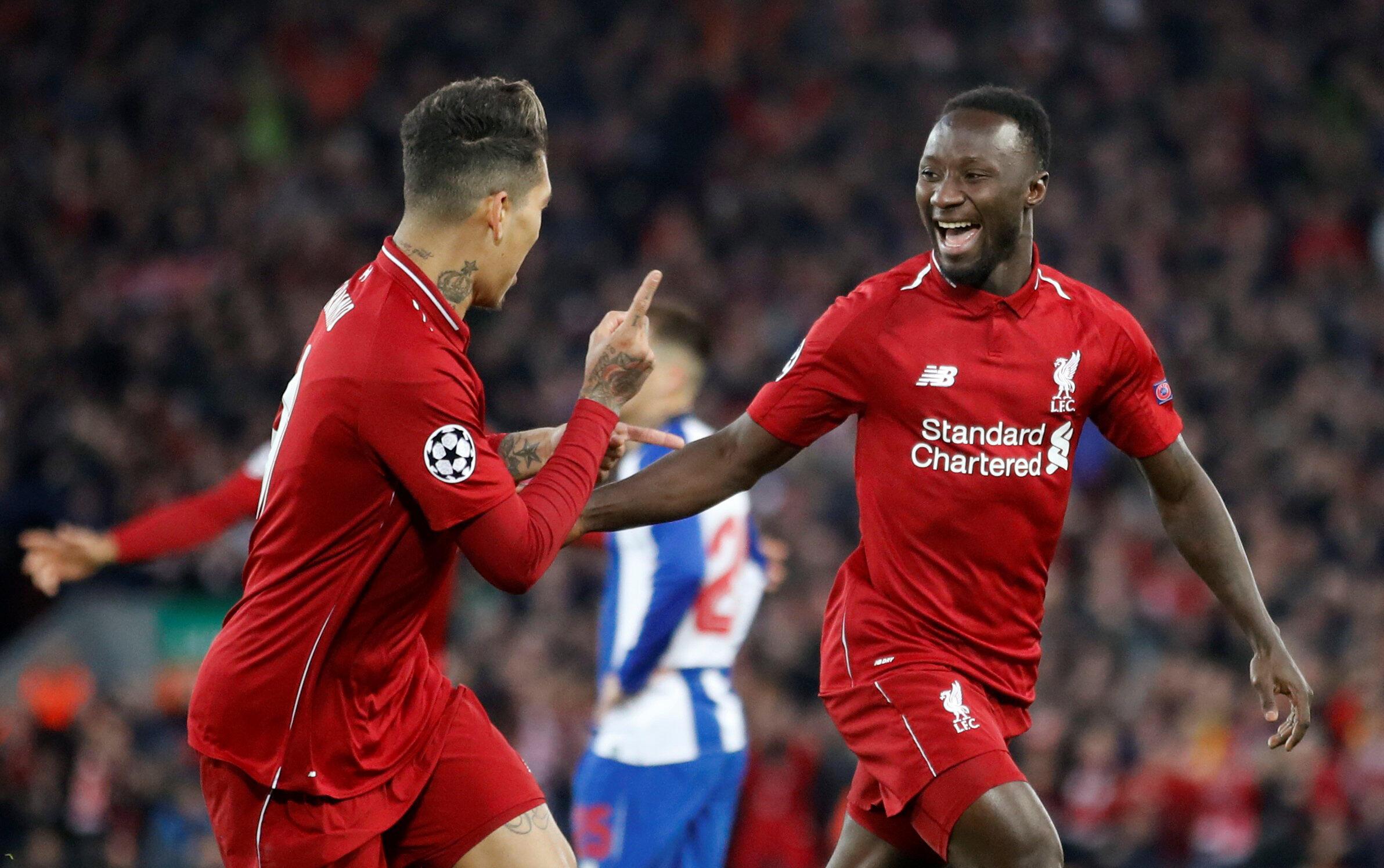 Le Guinéen Naby Keïta fête avec le Brésilien Roberto Firmino son premier but en Ligue des champions, avec Liverpool contre Porto le 9 avril 2019.