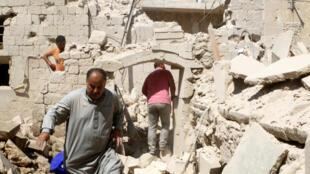 Quang cảnh một khu phố Aleppo, dưới quyền kiểm soát của phe nổi dậy, sau một trận oanh tạc, ngày 15/08/2016.
