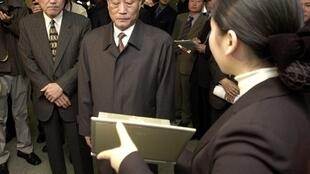 Pak Nam-Ki (middle) visiting South Korea in 2002.