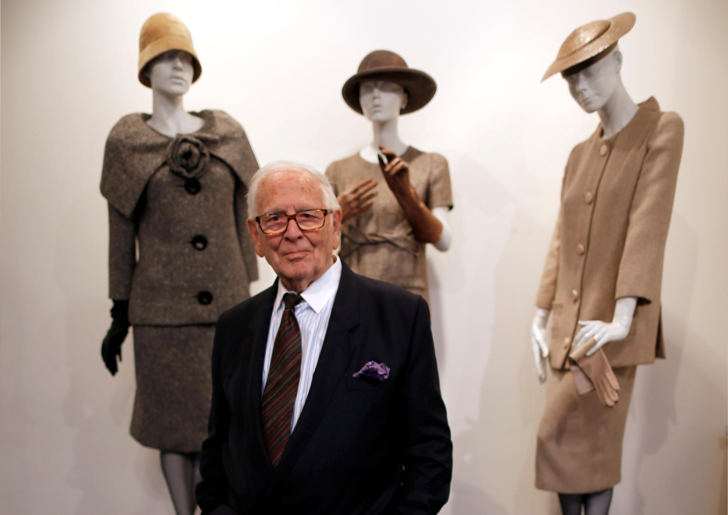 """French fashion designer Pierre Cardin poses in front of his 1954-1956-1957 fashion creations in his museum called """"Past-Present-Future"""" in Paris November 12, 2014."""