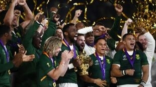 Skipper Siya Kolisi holds the Rugby World Cup trophy after South Africa beat England in the 2019 final in Japan