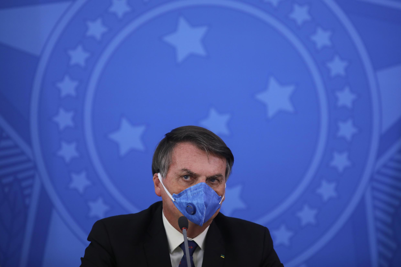 Brazil's President Jair Bolsonaro has downplayed the danger of the coronavirus and opposed lockdown measures as job-killing overreaction