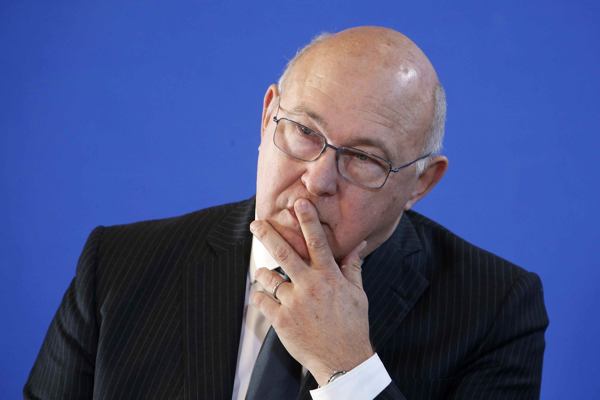 Finance minister Michel Sapin claims French companies would be undermined by the proposed tax evasion move