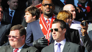 NBA superstar LeBron James, here attending an English Premier League match between Liverpool and Manchester United has become a partner in the Fenway Sports Group that owns the English Premiership club, baseball's Boston Red Sox and other global sports and entertainment concerns