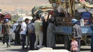 Des réfugiés syriens à la frontière avec le Liban, le 8 août 2014.