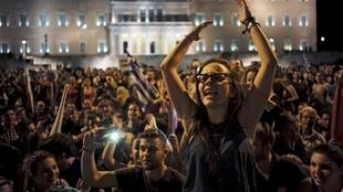 Greeks celebrate in Syntagma Square in Athens after the 'No' referendum vote, 5 July 2015.