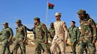 Fighters loyal to military commander Khalifa Haftar march during the morning assembly in the eastern city of Benghazi.