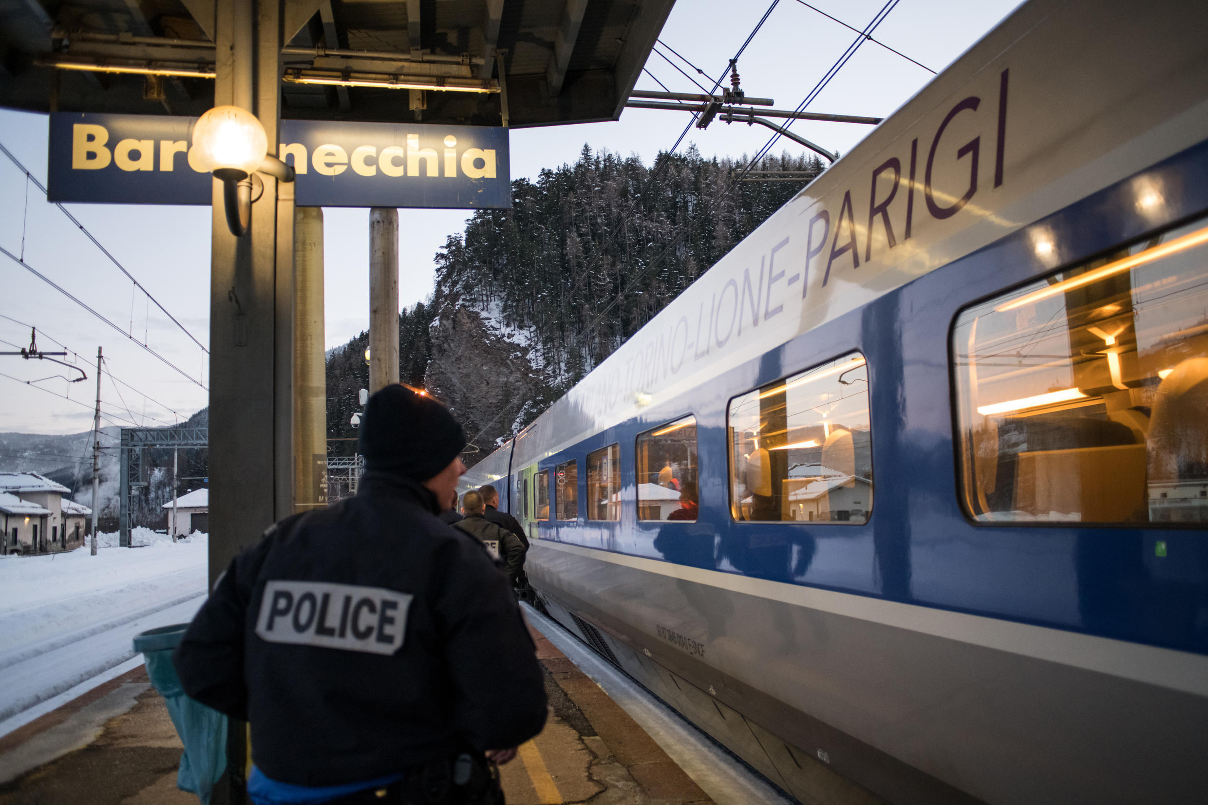 This file photo shows French police officers board a TGV train coming from Milan to Paris to control passengers at the Bardonecchia train station.