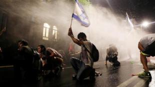 2020-07-30T093526Z_2046924371_RC2L3I92NYQW_RTRMADP_3_HEALTH-CORONAVIRUS-ISRAEL-PROTESTS