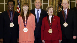 Beverly Cleary (2nd R) is pictured with president George W. Bush (center) in this November 12, 2003 photo, along with other recipients of the National Medal of Art (from L) blues musician Buddy Guy, dancer Suzanne Farrell and director Ron Howard