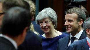 British Prime Minister Theresa May (C) with French President Emmanuel Macron at an EU summit last year