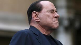 Бывший премьер Италии Сильвио Берлускони на митинге своих сторонников в Риме 04/08/2013