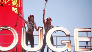 Femen activists on Moulin Rouge roof, Paris, 6 Oct.