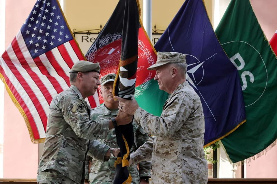 """General Austin """"Scott"""" Miller, commander of U.S. forces and NATO's Resolute Support Mission, hands over his command to U.S. Marine General Kenneth McKenzie, during a ceremony in Kabul, Afghanistan July 12, 2021."""