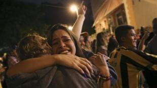 Simpatizantes de la oposición celebran la victoria en las calles de Caracas, el 7 de diciembre de 2015.