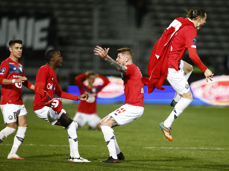 Festejos dos jogadores do Lille. A equipa francesa arrecadou o título de Campeão pela quarta vez na história.