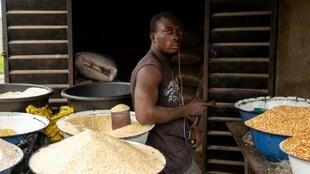A vendor at Badagry market: the days of heaping 50kg sacks of rice on the saddle of a motorbike and slipping a few notes to a customs officer are now gone.