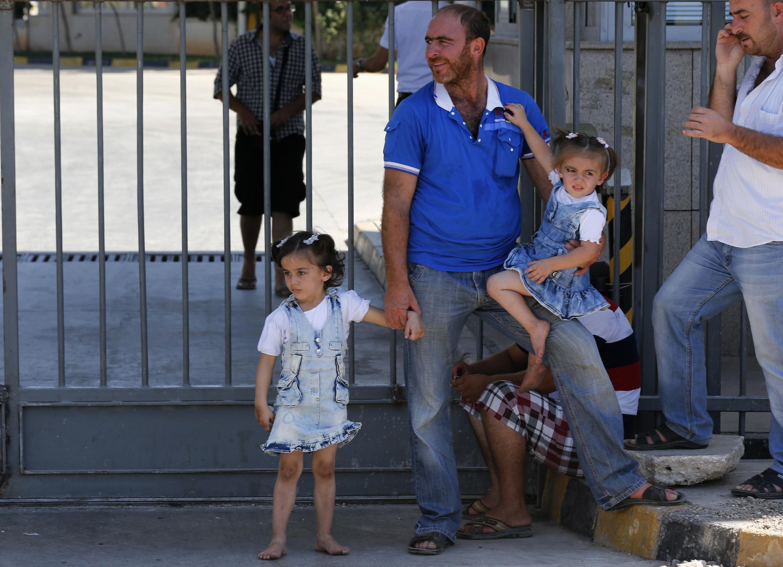 Famílias sírias  refugiadas em um campo na Turquia nesta terça-feira, 17 de setembro de 2013..