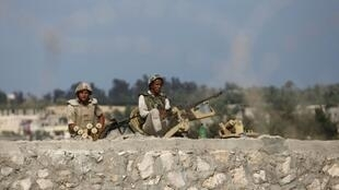 Egyptian soldiers keep guard on the border between Egypt and southern Gaza Strip, 8 July, 2013