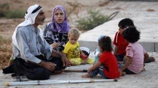 Famille de réfugiés syriens en Turquie, en août 2012.