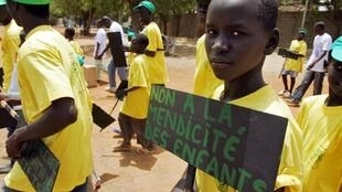 A student from a Koranic school in Dakar during a protest against child begging