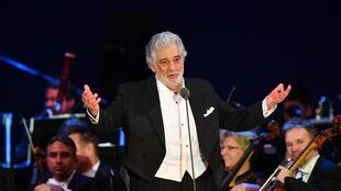 Spanish tenor Placido Domingo gestures as he performs during his concert in the newly inaugurated sports and culture centre 'St Gellert Forum' in Szeged, southern Hungary, on August 28, 2019.