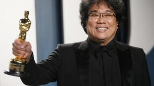 "Bong Joon Ho holds one of his Oscars for ""Parasite"" at the Vanity Fair Oscar party in Beverly Hills during the 92nd Academy Awards, in Los Angeles, California, U.S., February 9, 2020."