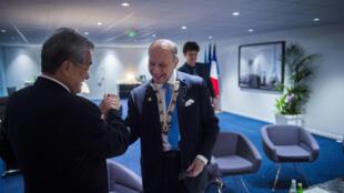 聯合國氣候大會主席,法國外交部長(右)對達成COP21最終協議有信心