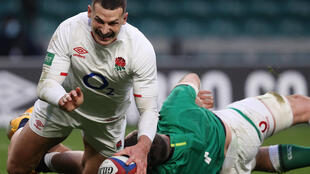 Try double - England wing Jonny May (L) scores the second of his two tries in an 18-7 Autumn Nations Cup win over Ireland at Twickenham