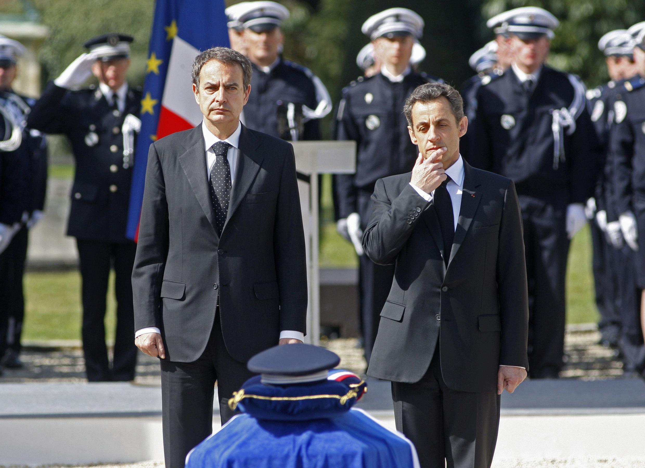 French President Nicolas Sarkozy (r) and Spanish Prime Minister Jose Luis Rodriguez Zapatero (l) at the memorial service of Jean-Serge Nérin on 23 March, 2010.