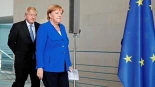 Boris Johnson et Angela Merkel à Berlin, le 21 août 2019.