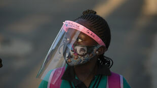 A student wearing a face mask and shield returns to the Melpark Primary School in Johannesburg, South Africa, 24 August 2020.