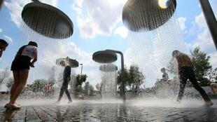 People cool off in city fountains to beat the heatwaves, becoming more recurrent in France and across Europe.