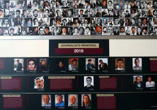 Pictures and names of journalists who were killed in 2018 while doing their job, are on display during the annual Journalist Memorial rededication ceremony at the Newseum on June 3, 2019