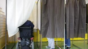 A man in a wheelchair votes in the 2012 presidential election