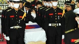 The mother of South Korean Marine Seo Jung-woo follows his coffin, carried by fellow-Marines.