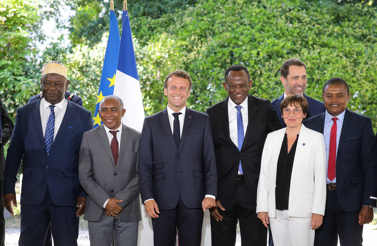 Emmanuel Macron with overseas minister Annick Girardin, interior minister Christophe Castaner and members of the delegation of the Mayotte territory in Paris, 8 July 2019.