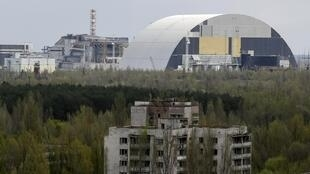The New Safe Confinement structure at the Chernobyl nuclear power plant is seen from Ukraine's abandoned town of Pripyat