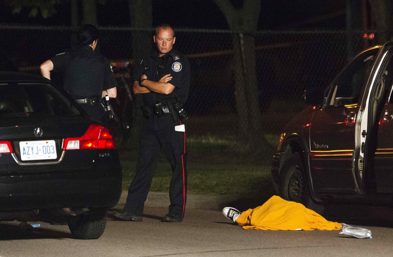 Fusillade lors d'une fête en plein air,  dans le quartier Scarborough, dans la banlieue est de Toronto, au Canada, le 17 juillet 20012.