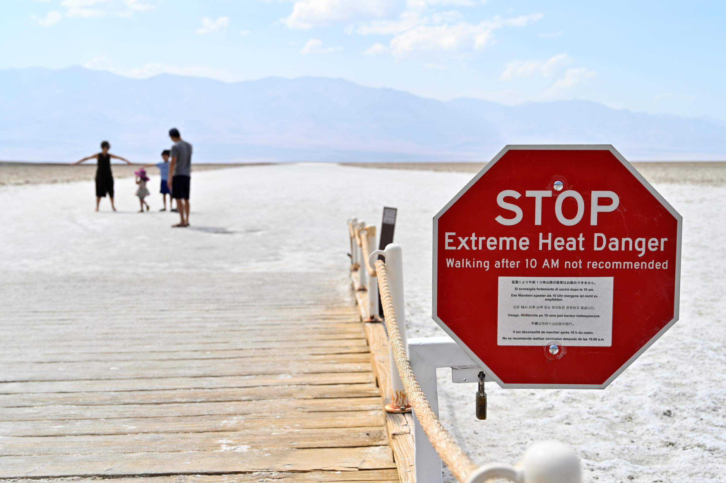 A warning sign alerts visitors of the extreme heat dangers at Badwater Basin, the lowest point in North America at 279 feet below sea level, in Death Valley National Park, California, U.S. August 17, 2020.  REUTERS/David Becker