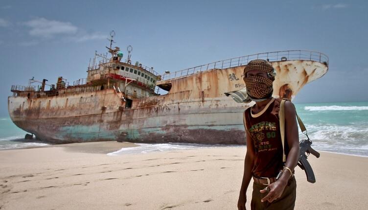 An armed gunman near the port of Hobyo, Somalia