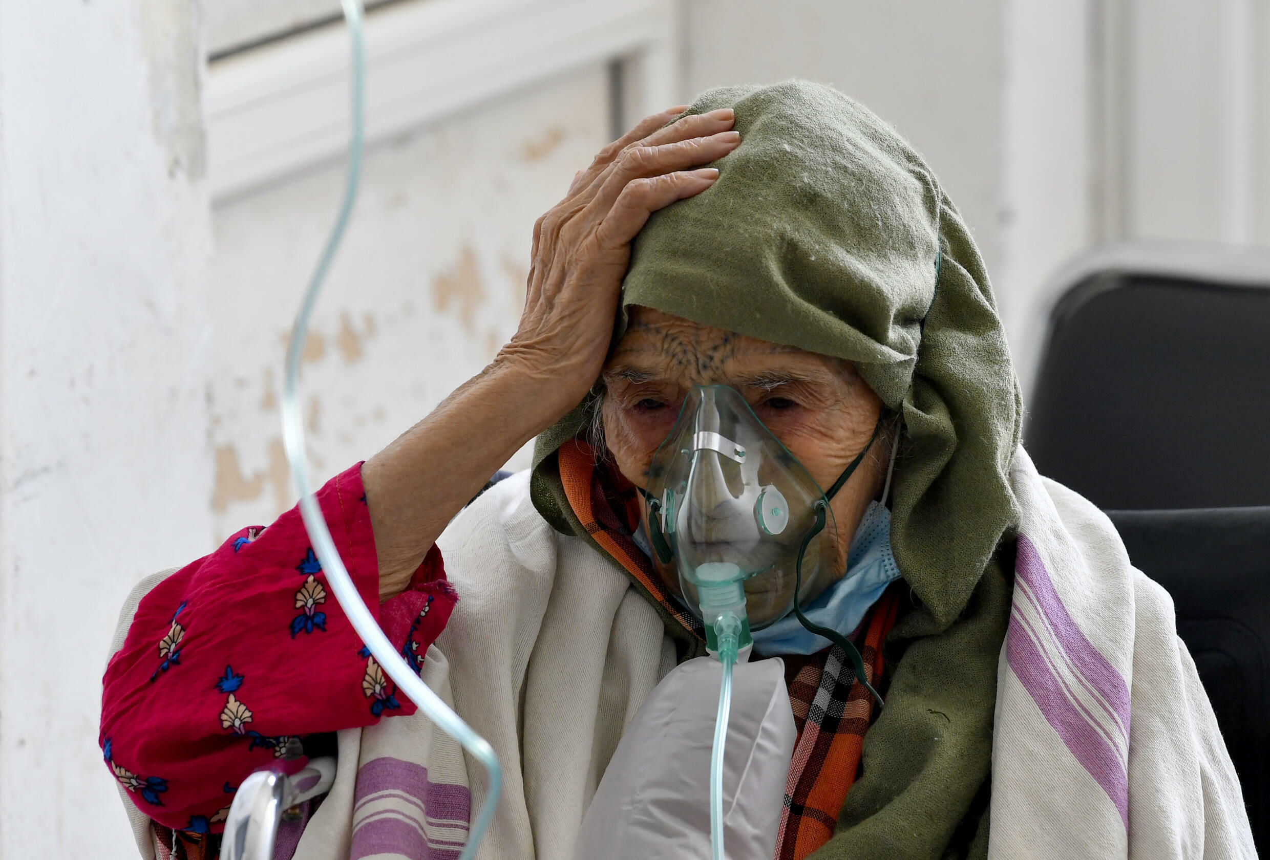 A woman with Covid-19 receives oxygen at the Ibn Jazzar hospital in  Kairouan on July 4, 2021