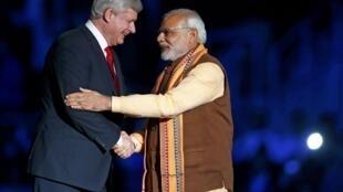 លោកនាយករដ្ឋមន្រ្តីកាណាដា Stephen Harper និងលោកនាយករដ្ឋមន្រ្តីឥណ្ឌា Narendra Modi
