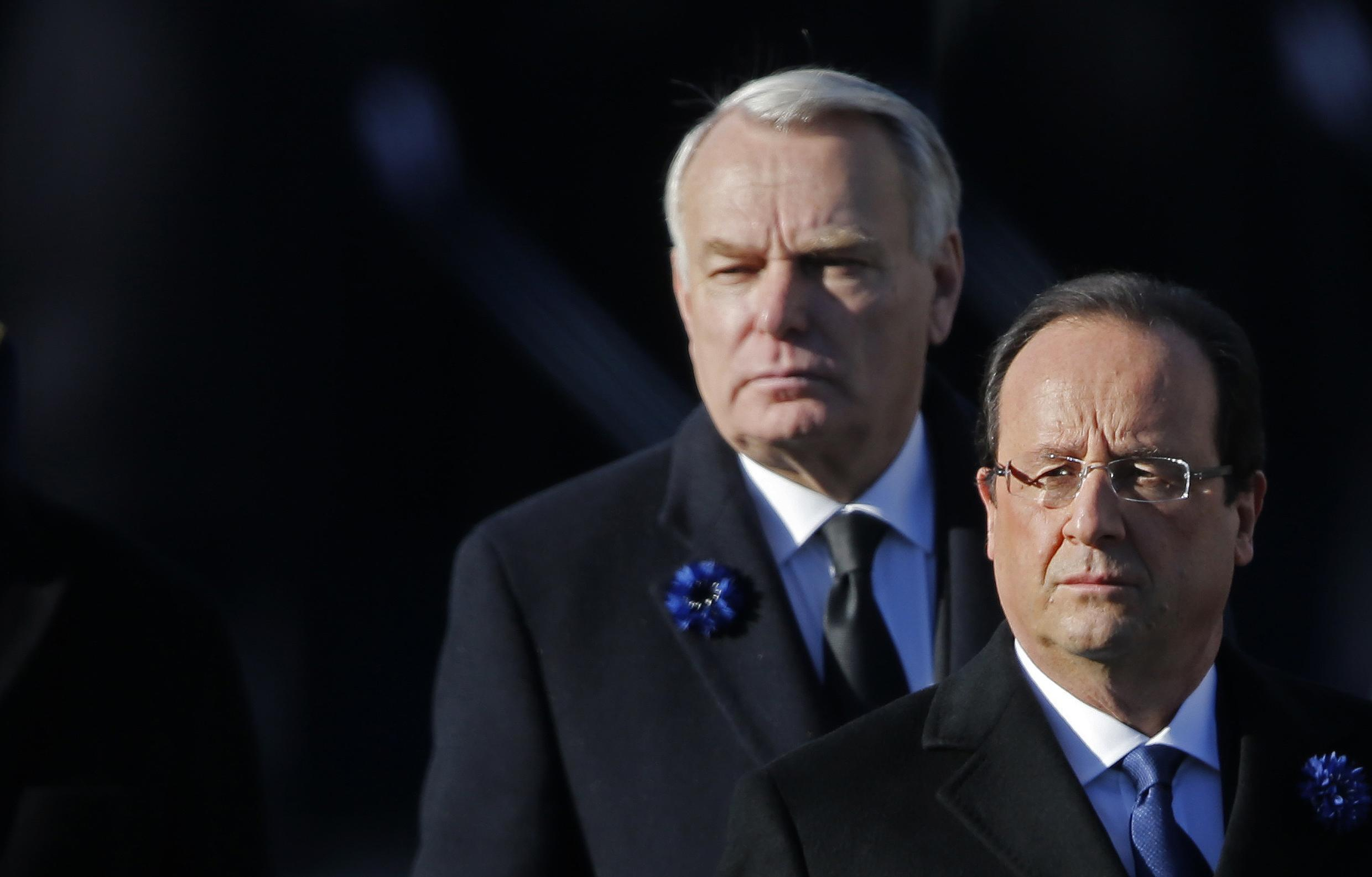 How was 2013 for them? French Prime Minister Jean-Marc Ayrault (L) and President François Hollande