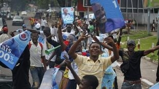 Supporters of incumbent President Joseph Kabila celebrate after provisional election results are announced in capital Kinshasa