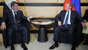 O presidente egípcio Mohamed Morsi (esq) durante encontro com seu homólogo russo, Vladimir Putin. O líder da Irmandande Muçulmana está em visita aos Brics e chega ao Brasil nesta terça-feira, dia 7 de maio.
