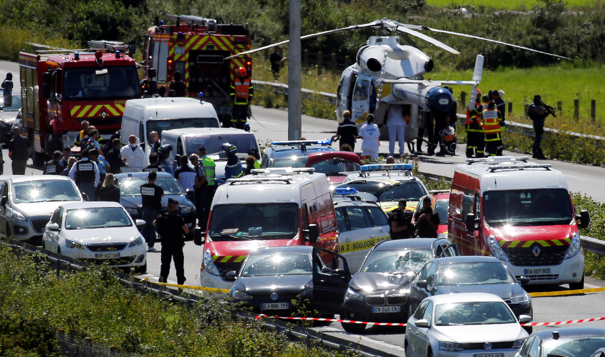 Police and rescue forces are seen on the scene where the man suspected of ramming a car into a group of soldiers on Wednesday in the Paris suburb of Levallois-Perret was shot and arrested on the A16 motorway, near Marquise, France, August 9, 2017.